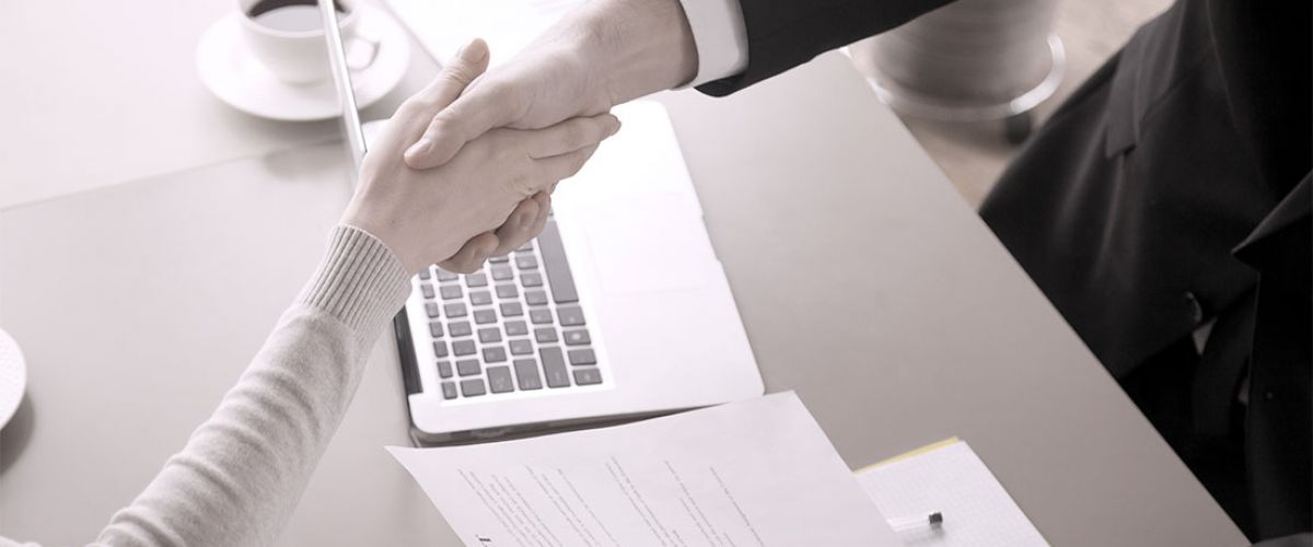 Business man and woman resolving a conflict and shaking hands